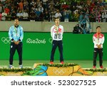 Small photo of RIO DE JANEIRO, BRAZIL - AUGUST 14, 2016:Juan Martin Del Porto ARG (L), Olympic champion Andy Murray GBR and Kei Nishikori JPN during tennis men's singles medal ceremony of the Rio 2016 Olympic Games