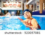 girl child swimmer in a red... | Shutterstock . vector #523057081