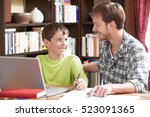 boy studying with home tutor   Shutterstock . vector #523091365