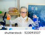 young girl making science... | Shutterstock . vector #523093537