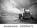 An Old Tractor Standing Next T...