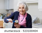 senior woman taking lid off jar ... | Shutterstock . vector #523100404