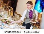 restaurant waitress serving...   Shutterstock . vector #523133869
