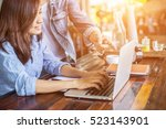 two young business working on... | Shutterstock . vector #523143901