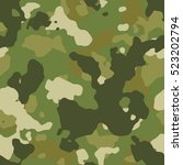 Seamless fashion green woodland camouflage pattern vector