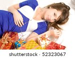 girls lie near present boxes - stock photo