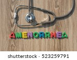 Small photo of Amenorrhea colorful word on the wooden background with stethoscope