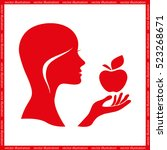woman holding an apple in his...   Shutterstock .eps vector #523268671