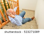 senior man falling down on... | Shutterstock . vector #523271089