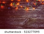 Christmas Lights On A Wooden...