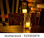 burning candle in a glass vase... | Shutterstock . vector #523302874