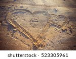 a two hearts in the sand on the ... | Shutterstock . vector #523305961