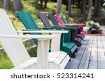 a row of muskoka chairs sitting ... | Shutterstock . vector #523314241