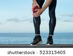 pain in knee injury of sportsman | Shutterstock . vector #523315405