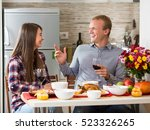 young couple having a dinner... | Shutterstock . vector #523326265
