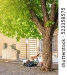 unrecognizable tourist resting... | Shutterstock . vector #523358575