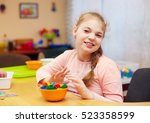 cute happy girl with disability ... | Shutterstock . vector #523358599
