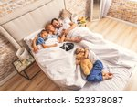 Stock photo family sleeping together on bed 523378087