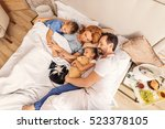 children sleeping with their... | Shutterstock . vector #523378105