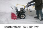 A Man Cleaning Snow With...