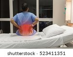 Small photo of Soft focus a male patient has spine injury or fracture spine, post operative on the bed in hospital ward room.