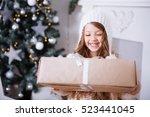 little girl with christmas... | Shutterstock . vector #523441045