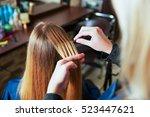 professional hairdresser uses... | Shutterstock . vector #523447621