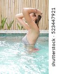 young woman relaxing in the pool | Shutterstock . vector #523447921