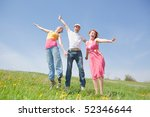 happy people is jumping in field | Shutterstock . vector #52346644