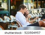 young romantic couple drinking... | Shutterstock . vector #523504957