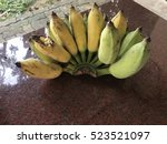 banana on dark brown table | Shutterstock . vector #523521097