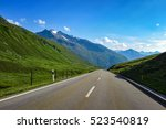 country road in the alps | Shutterstock . vector #523540819