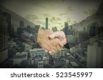 abstract businessman shakehand for commitment business with vignette filter for corruption idea - can use to display or montage on product - stock photo