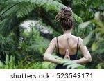 silence yin yoga in jungle in... | Shutterstock . vector #523549171