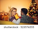 couple enjoying christmas mood... | Shutterstock . vector #523576555
