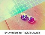 sunglasses laying beside...   Shutterstock . vector #523600285