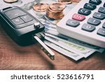 key from the car and calculator ... | Shutterstock . vector #523616791