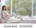 young beautiful pregnant woman... | Shutterstock . vector #523624405