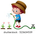 boy watering plants with hose... | Shutterstock .eps vector #523634539