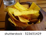 fried plantain chips in a... | Shutterstock . vector #523651429
