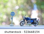 the toy motorcycle lover | Shutterstock . vector #523668154