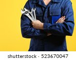 mechanic with crossed arms and... | Shutterstock . vector #523670047