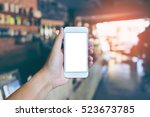 man's hand shows mobile... | Shutterstock . vector #523673785