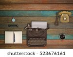 vintage typewriter and coffee... | Shutterstock . vector #523676161