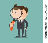 businessman looking through a... | Shutterstock .eps vector #523698859