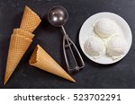 Stock photo ice cream scoops on dark background top view 523702291