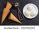 Stock photo ice cream scoops on dark background top view 523702291