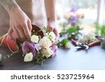 male florist making bouquet at... | Shutterstock . vector #523725964