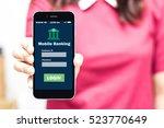 female hands hold mobile...   Shutterstock . vector #523770649
