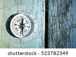 compass on old wood table  find ... | Shutterstock . vector #523782349